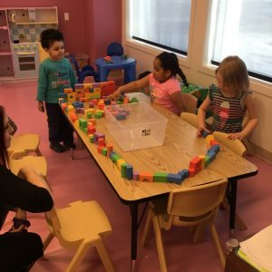 Group of daycare kids building together